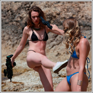 Bikini gunfight in the rocks – Renee vs Blanca